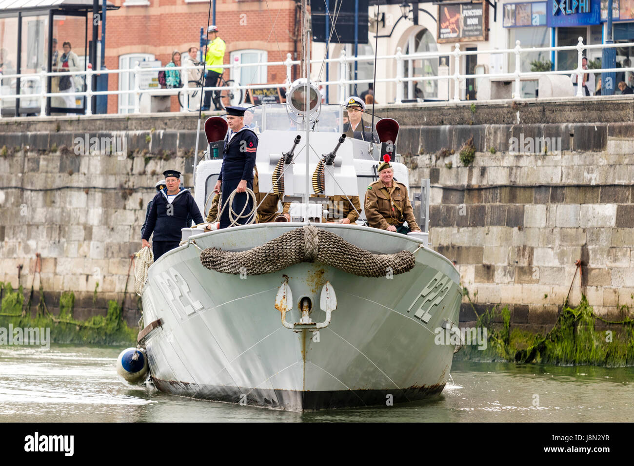 Dunkirk evacuation re-enactment at Ramsgate harbour in England. US type 21 patrol boat, the restored P22 approaching - Stock Image