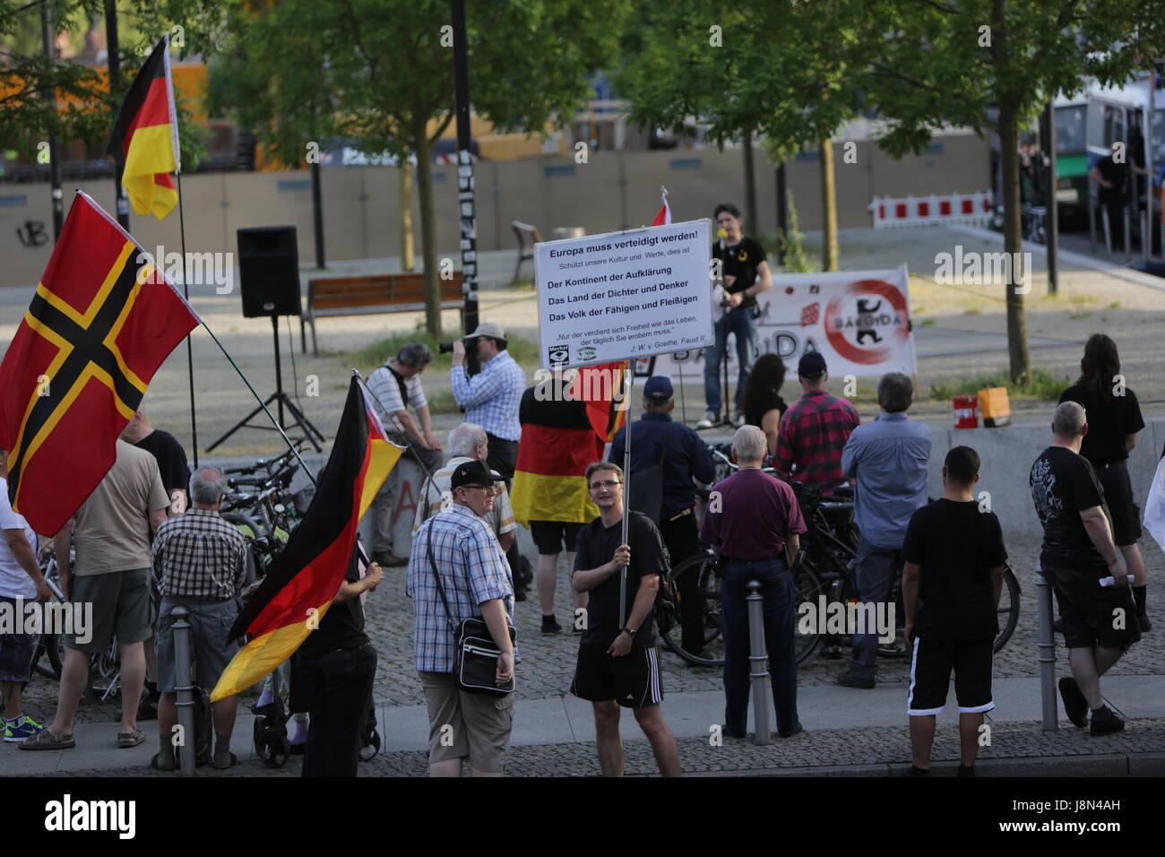 Protesters wave a Wirmer flag and German flags. A handful of right-wing protesters came to their weekly rally in - Stock Image