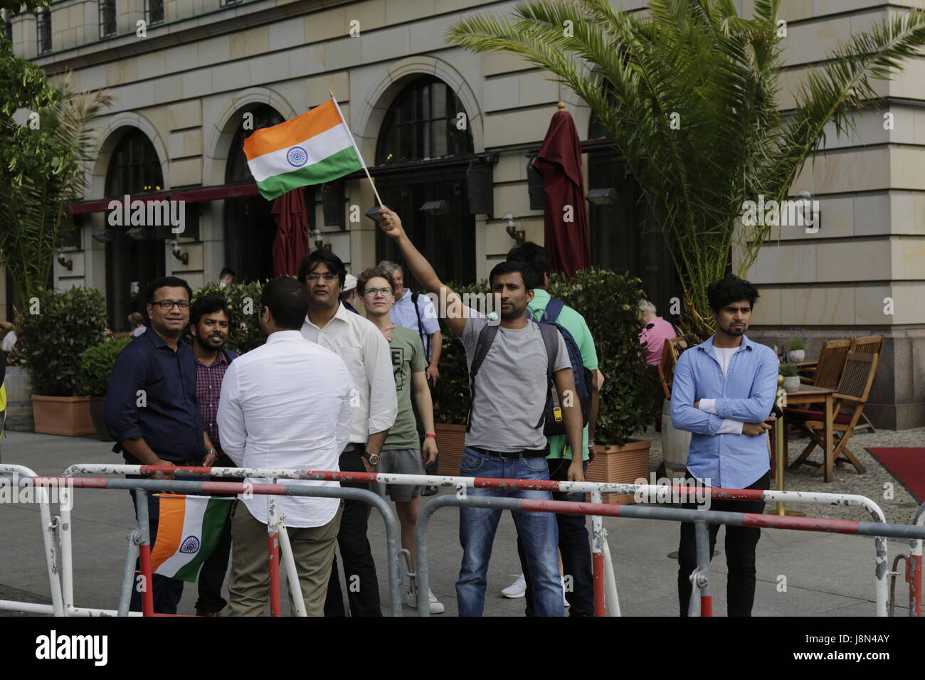Indian supporters of Prime Minister Modi shout at the Kashmiri counter protesters. The Prime Minister of India, - Stock Image