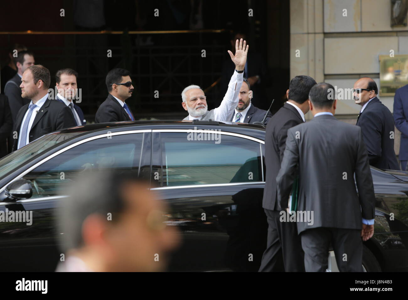 Narendra Modi waves at a group of supporters. The Prime Minister of India, Narendra Modi, has started his visit - Stock Image