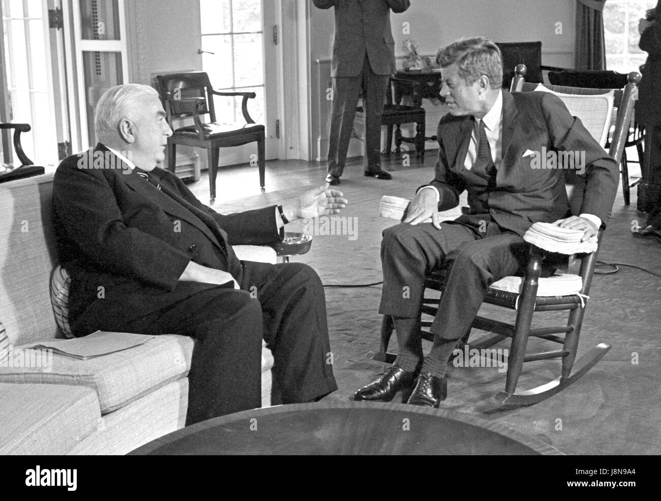 jfk in oval office. United States President John F. Kennedy (in Rocking Chair), Right, Meets With Prime Minister Of Australia Robert G. Menzies, Left, In The Oval Office Jfk D