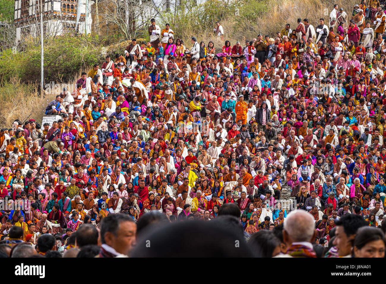 King and Queen Of Bhutan sitting among their subjects at Paro Tsechu, the biggest religious festival celebrated - Stock Image