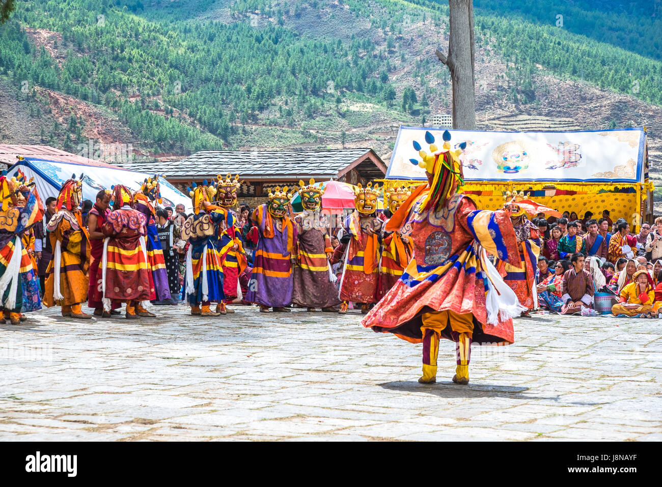 This ancient ritual mask dance also known as Cham is performed at religious festivals known as tsechu in Bhutan - Stock Image