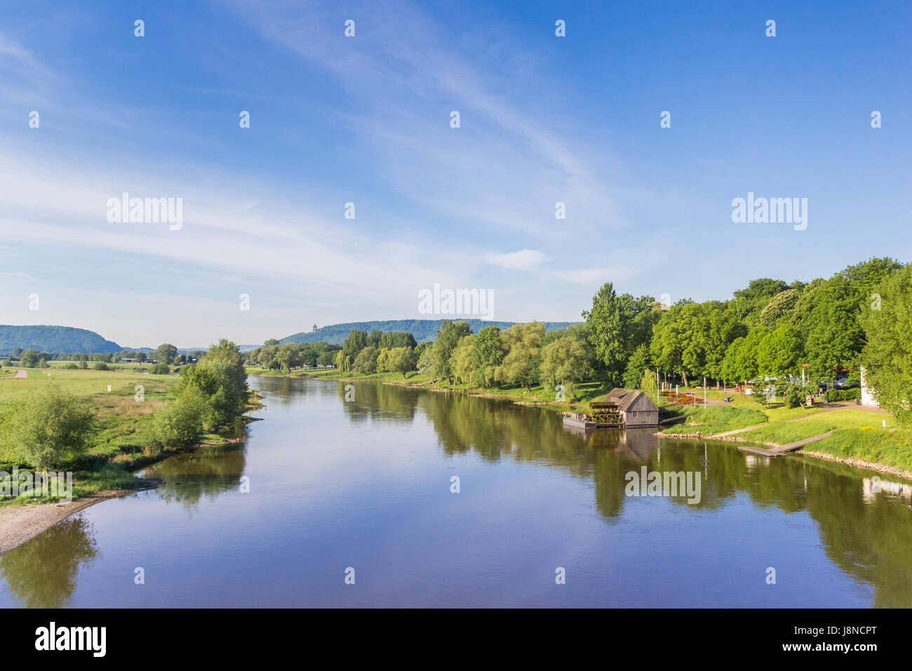 River Weser and old wooden mill near Minden, Germany - Stock Image