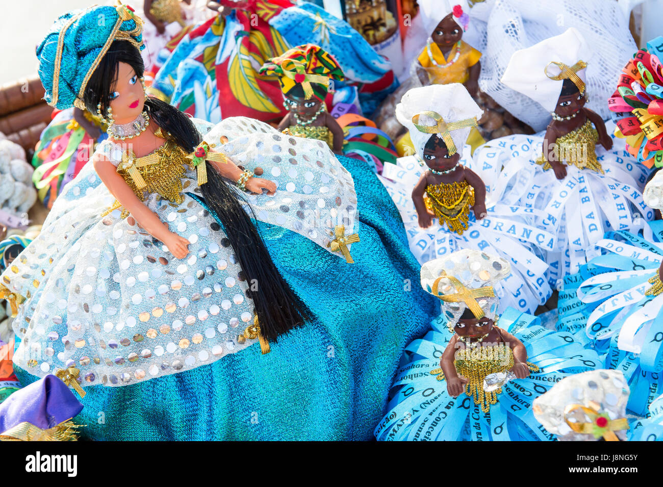 Souvenir figurines of the Yoruba goddess Yemanja stand on display at the annual festival dedicated to her in Salvador, - Stock Image