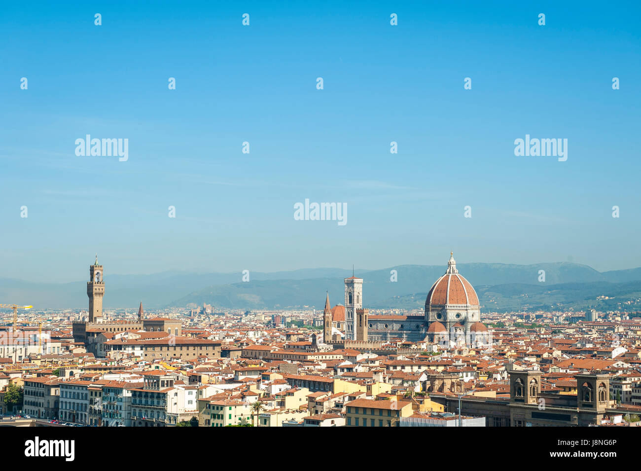 Scenic skyline view of Florence, Italy dominated by the terra-cotta dome of the Cattedrale di Santa Maria del Fiore - Stock Image