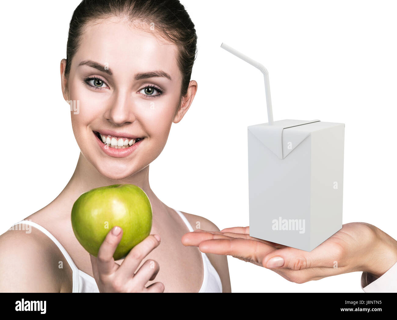 happy young woman holds an apple near juice box template healthy