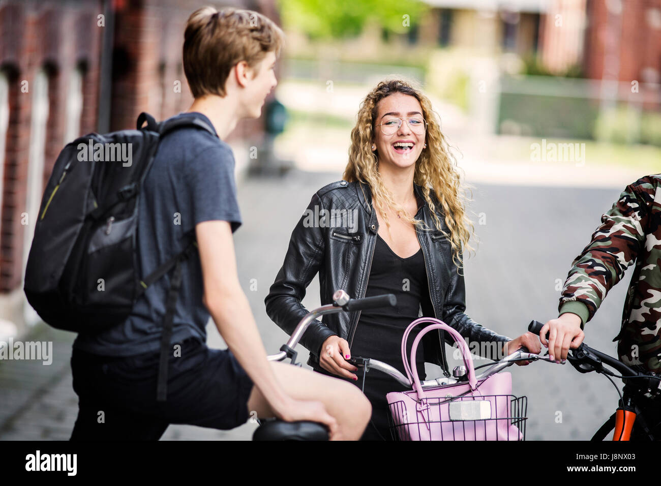 Students (14-15) smiling - Stock Image