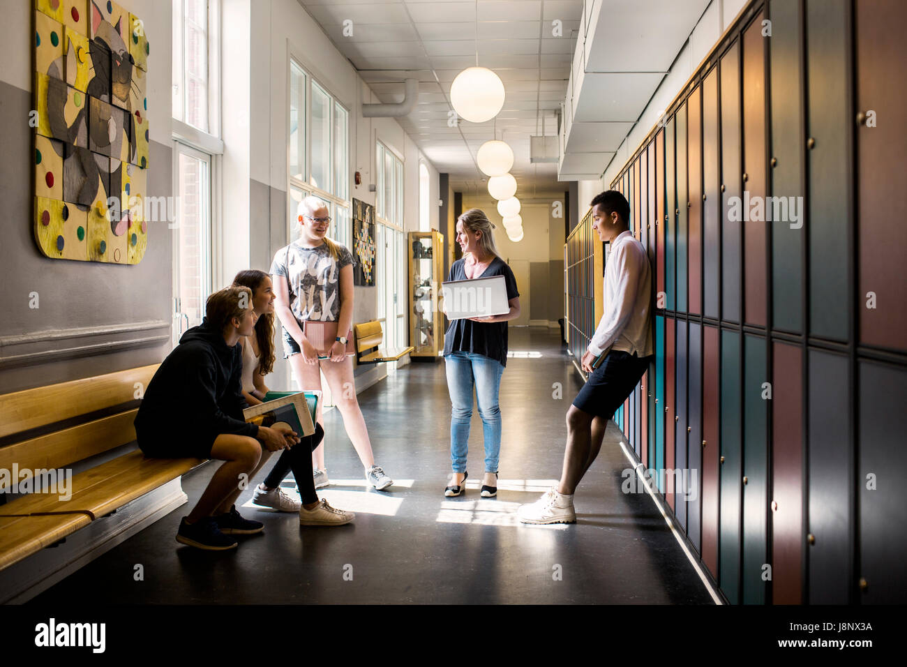Students (14-15) in corridor Stock Photo