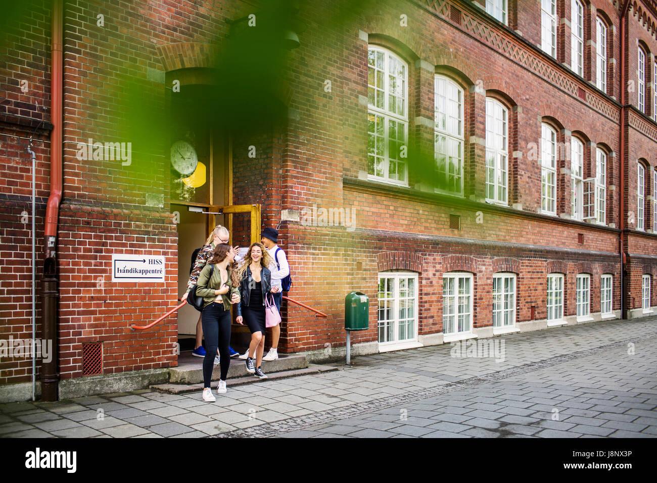 Students (14-15) leaving school Stock Photo