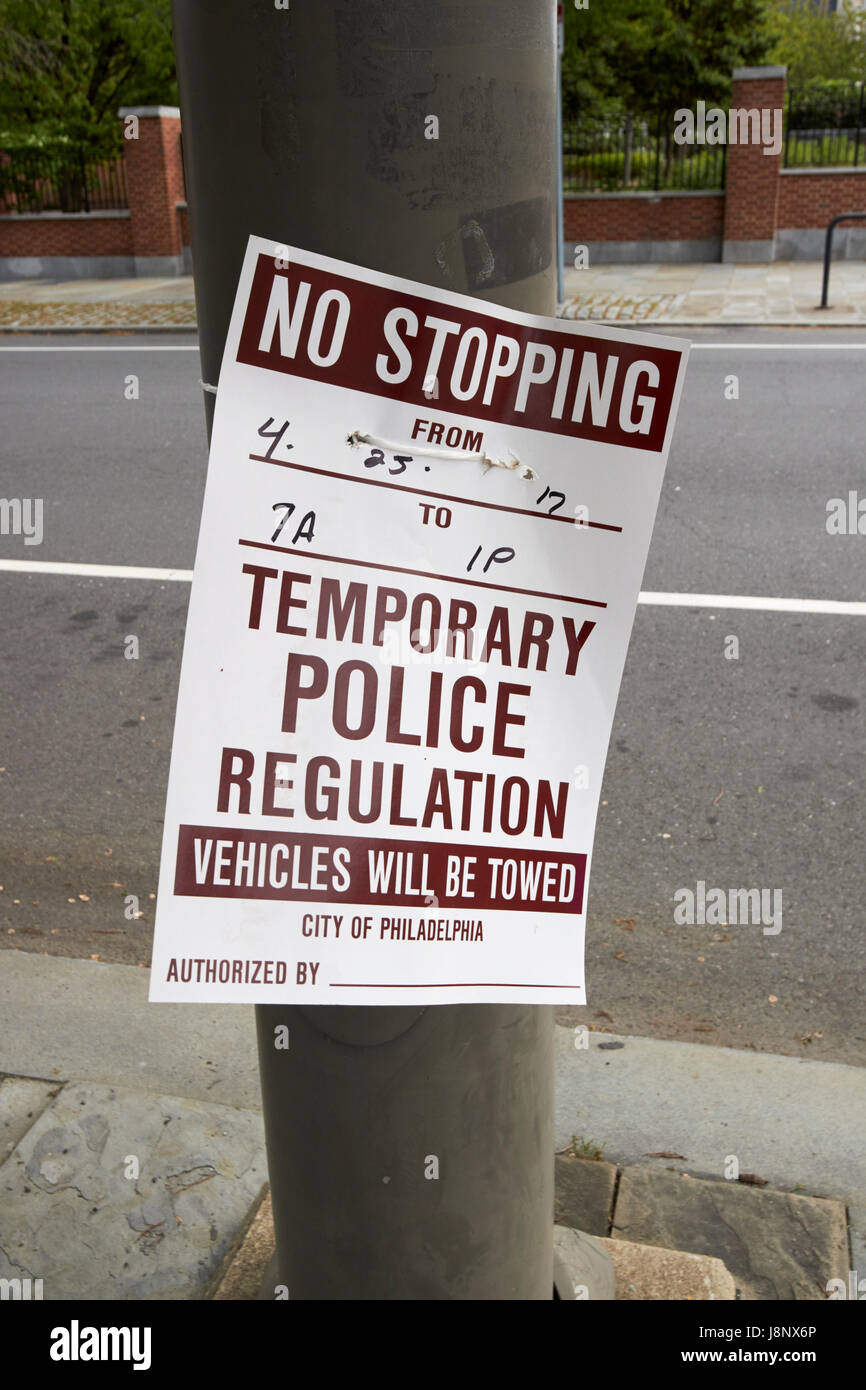 temporary police regulation cardboard sign no stopping vehicles will be towed Philadelphia USA - Stock Image
