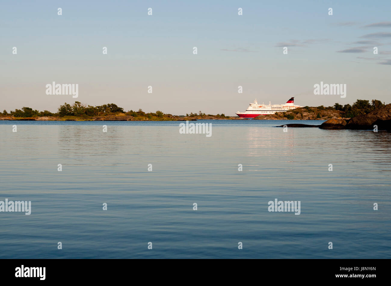 Ferry ship at sunset Stock Photo
