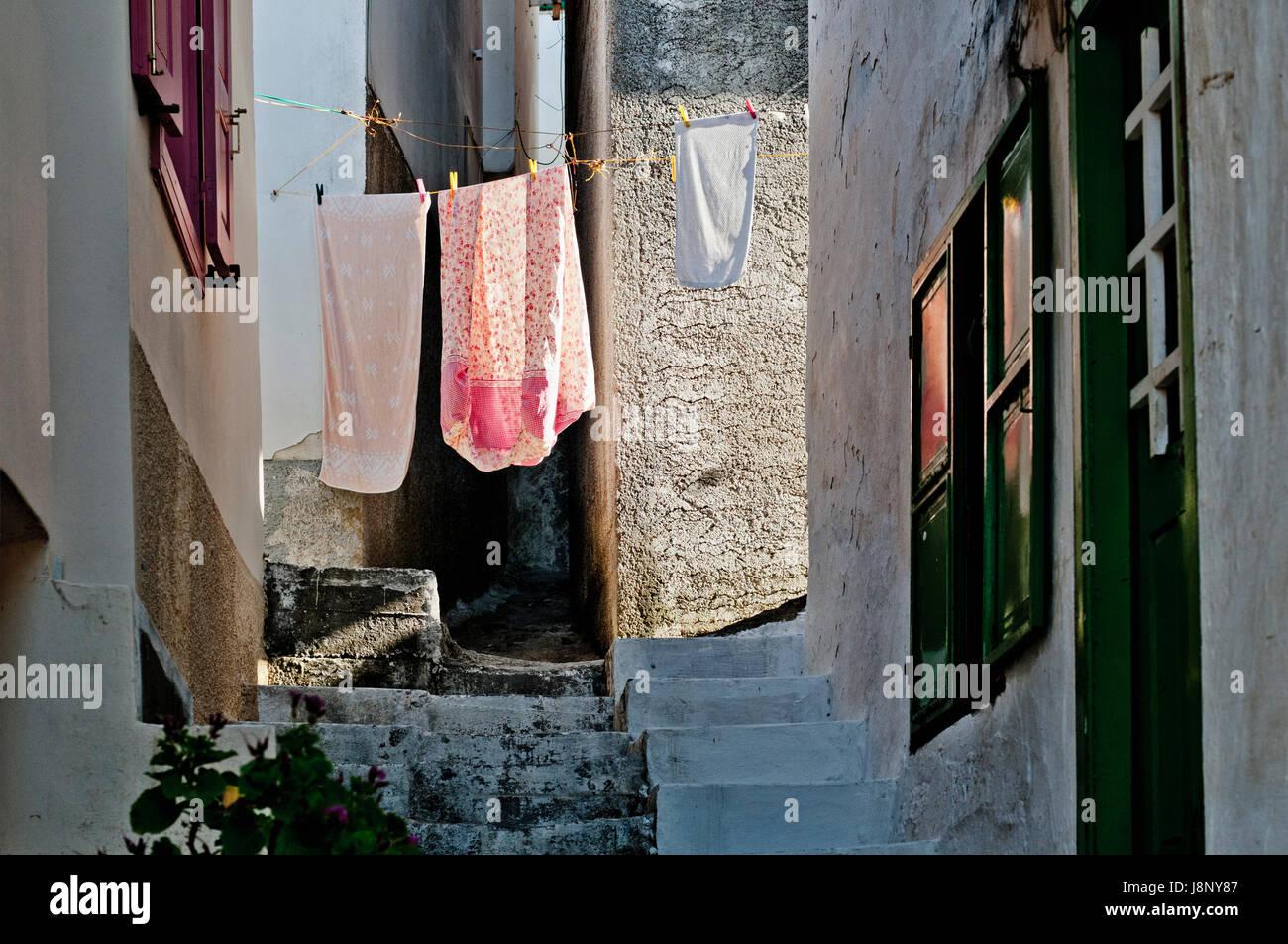 Clothesline in narrow street Stock Photo