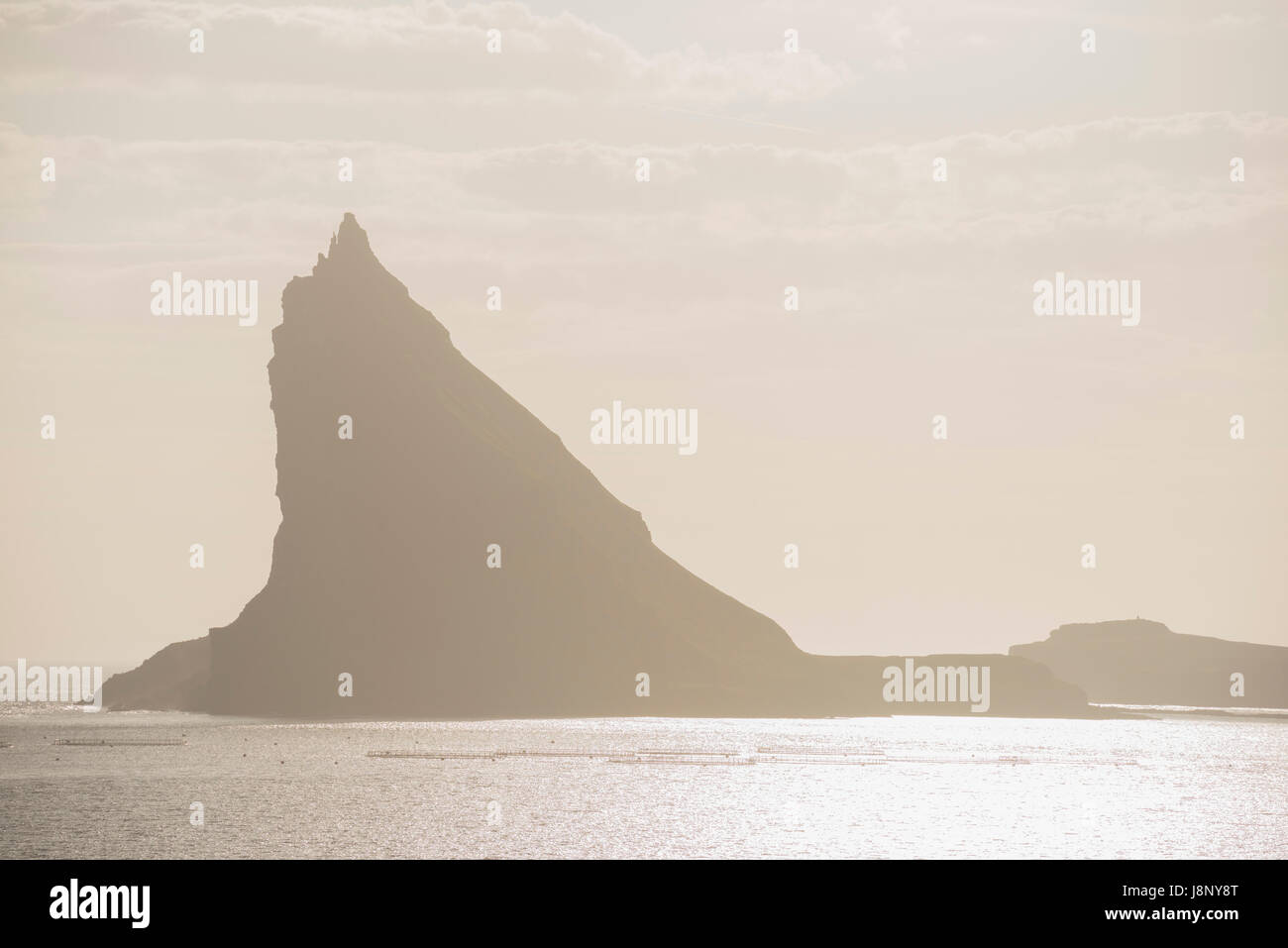 Silhouette of mountain by sea Stock Photo