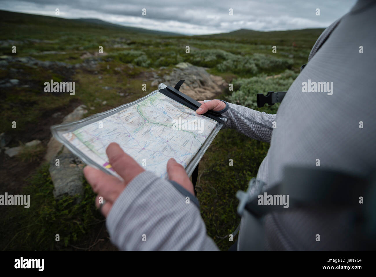 Man holding map Stock Photo