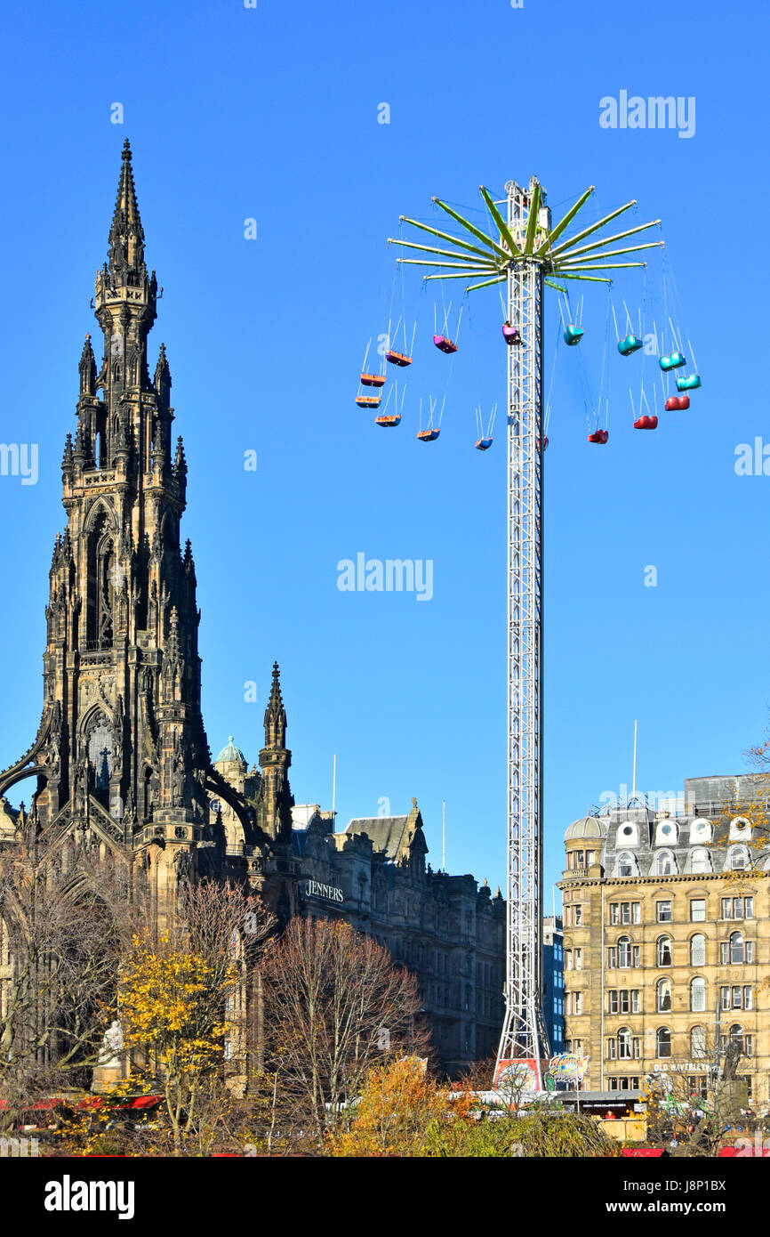 Edinburgh star flyer type fairground ride operating beside the Victorian Scott Monument at the annual European Christmas - Stock Image