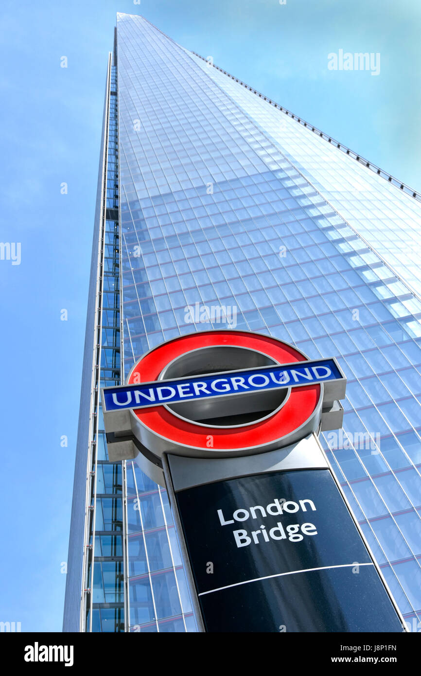 London Bridge underground station roundel sign in front of Shard landmark skyscraper all part of the London Bridge - Stock Image