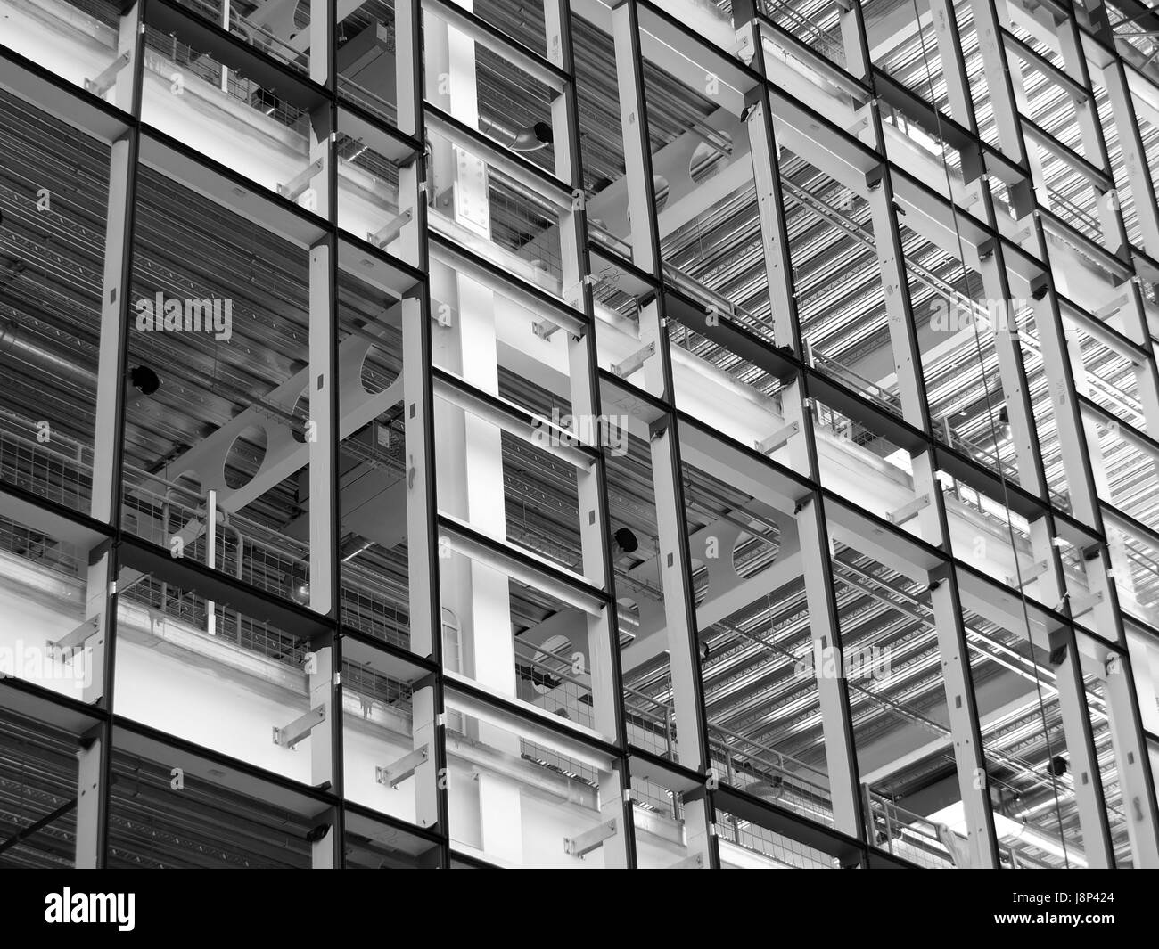construction work with modern steel framed building and girders - Stock Image