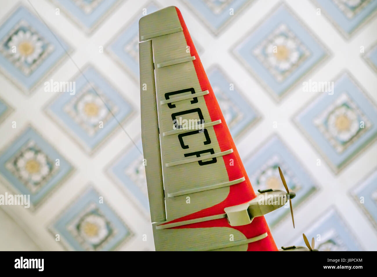 Model of the vintage Soviet airplane hanging  in the air - Stock Image