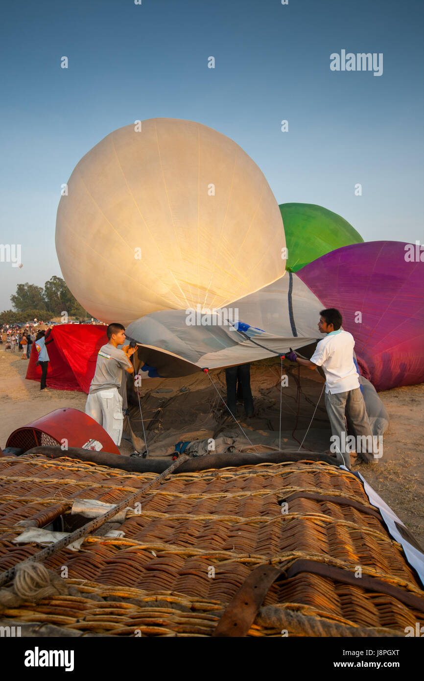 Crews prepare hot air balloon cold inflation before fly in hot air Thailand International Balloon Festival 2009 Stock Photo
