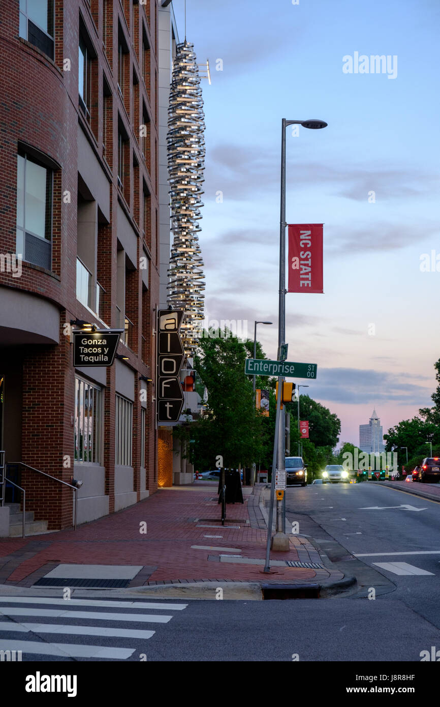 Aloft Hotel on Hillsborough Street at dusk on campus of North Carolina State University, Raleigh, USA Stock Photo
