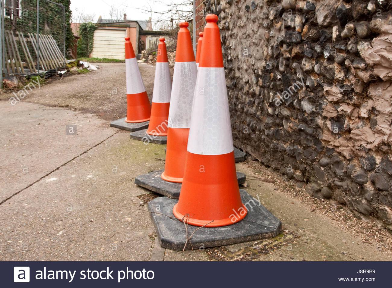 object, stone, four, rock, concrete, wall, standing, shape, orange, - Stock Image
