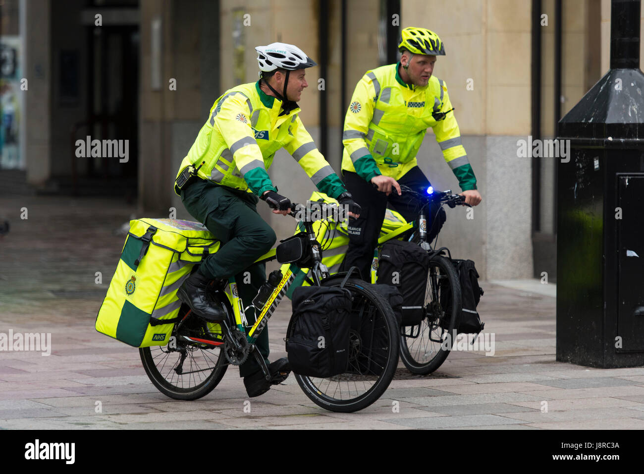 Ambulance first responders on bicycles in Cardiff, Wales, UK. - Stock Image