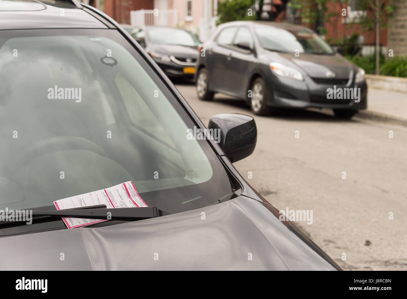 Montreal, CA - 25 May 2017: A parking ticket on a car on Laurier Street - Stock Image