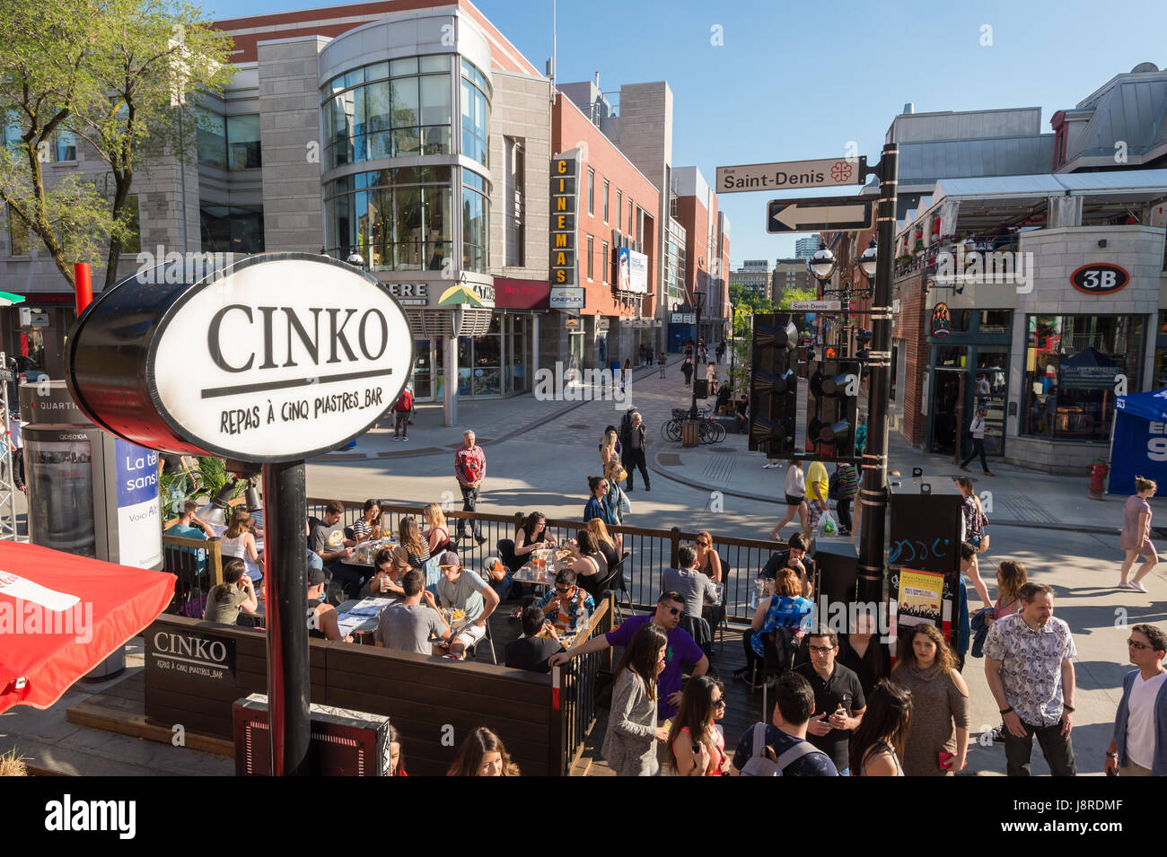 Montreal, CA - 27 May 2017: St-Denis street is turned into a pedestrain zone during 'Terrasses au Quartier Latin' - Stock Image