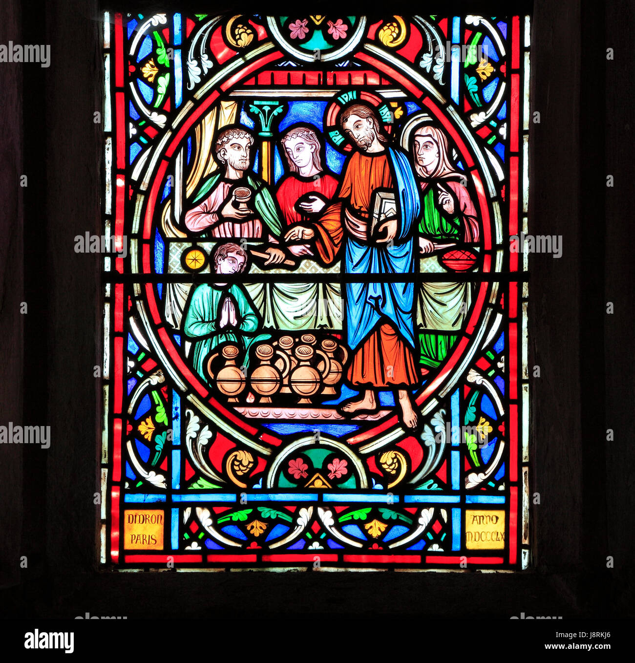 Scene from Life of Jesus, by Adolph Didron, Paris, 1860, stained glass window, Feltwell, Norfolk. Jesus at Cana - Stock Image