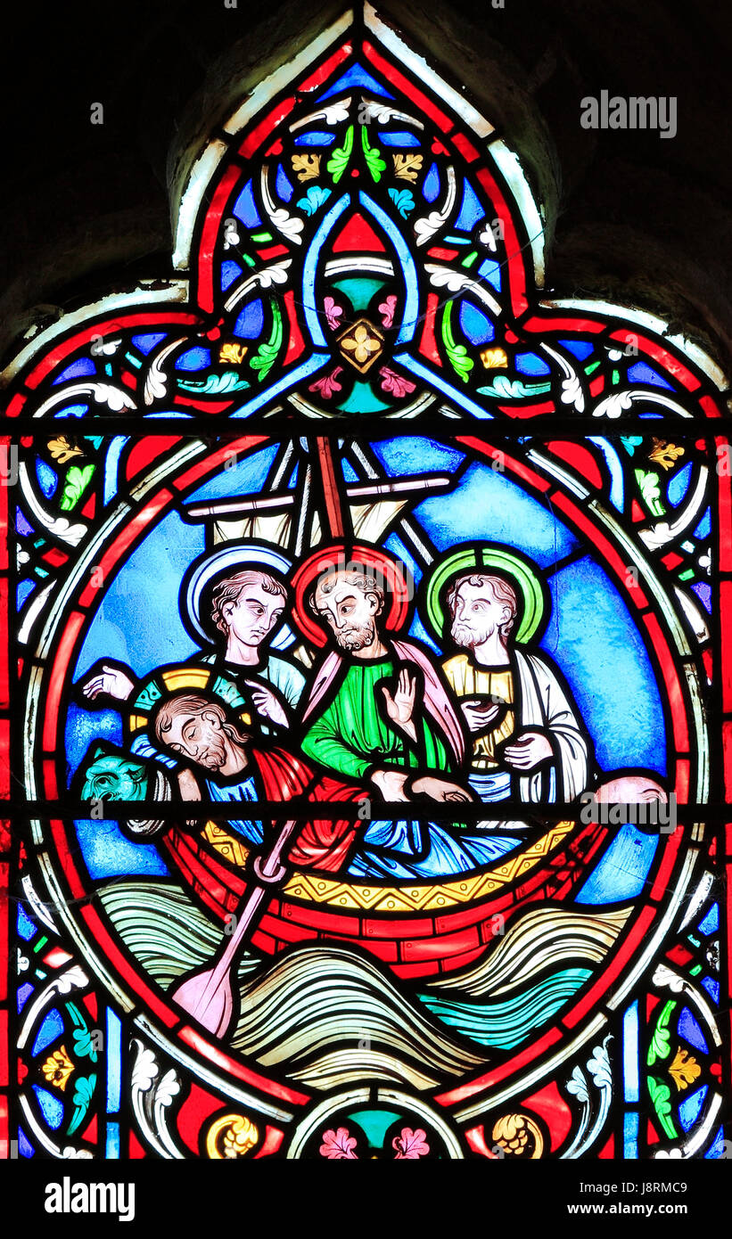 Scene from Life of Jesus, by Adolph Didron, Paris, 1860, stained glass window, Feltwell, Norfolk. Jesus sleeps in - Stock Image