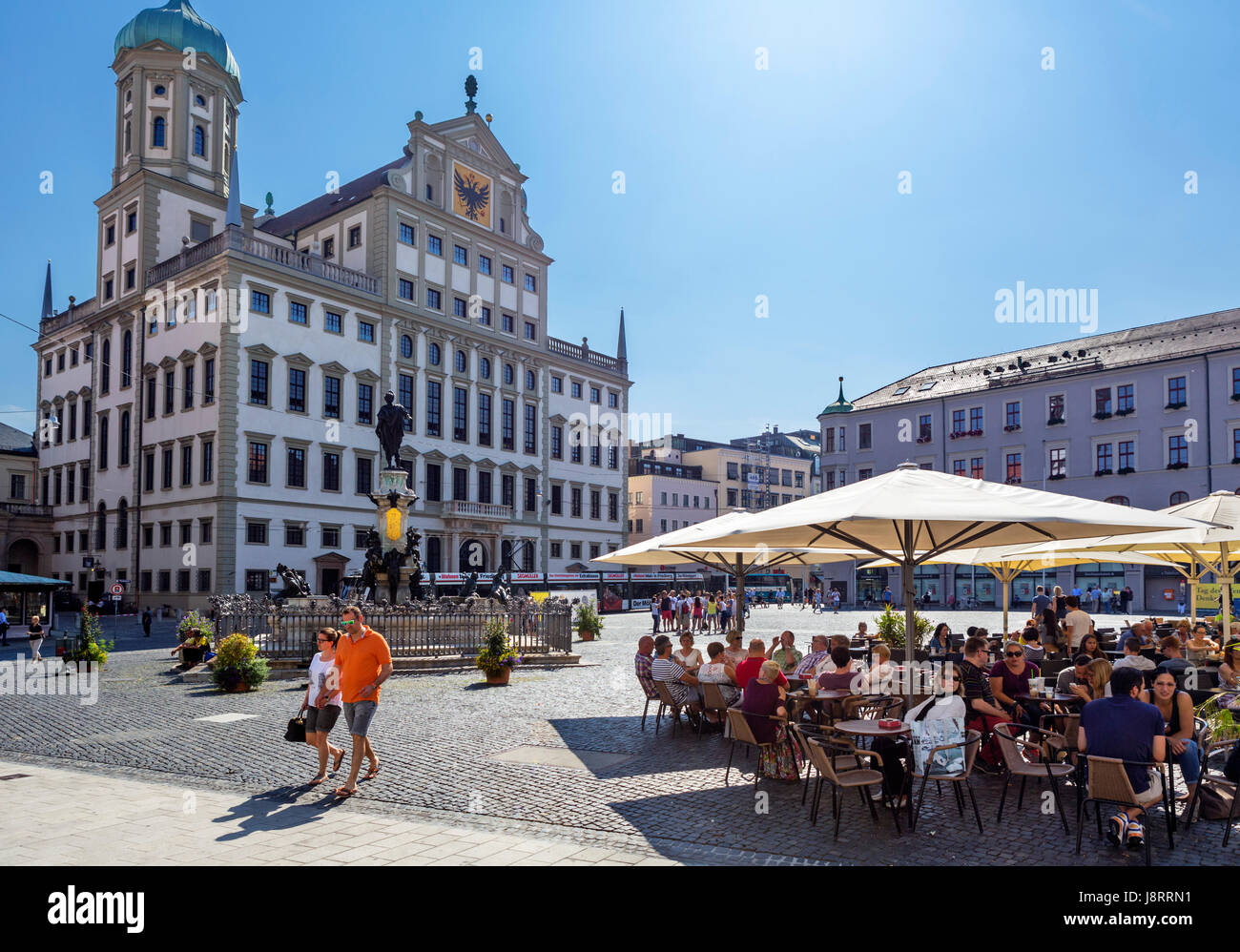 Sidewalk cafe in front of the Town Hall (Rathaus), Rathausplatz, Augsburg, Bavaria, Germany - Stock Image