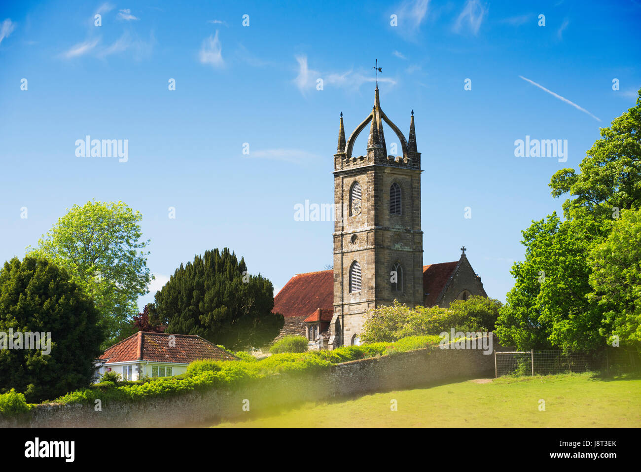 All Hallows church in the village of Tillington close to Petworth with its Scots Crown Spire, West Sussex, UK Stock Photo