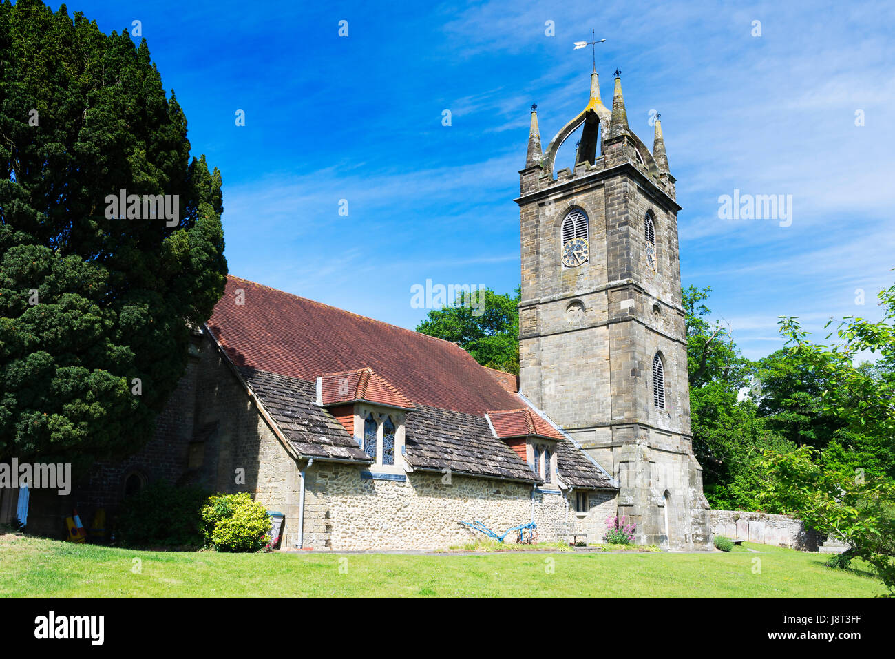 The Church of All Hallows in the village of Tillington near Petworth on a bright spring morning, West Sussex, UK Stock Photo