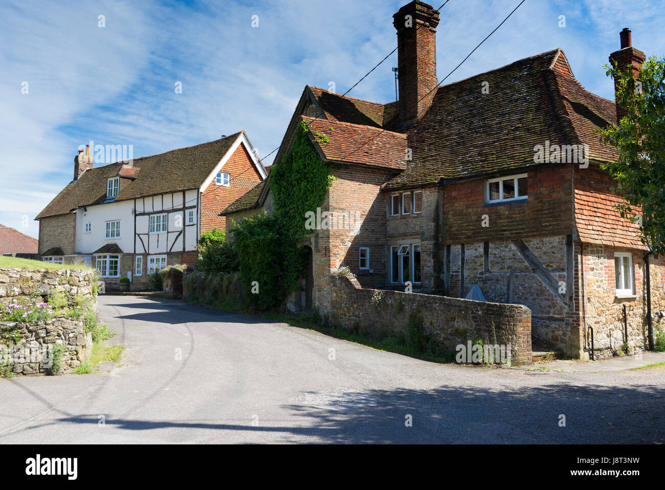 The village of Tillington west of Petworth on a bright spring afternoon - Stock Image