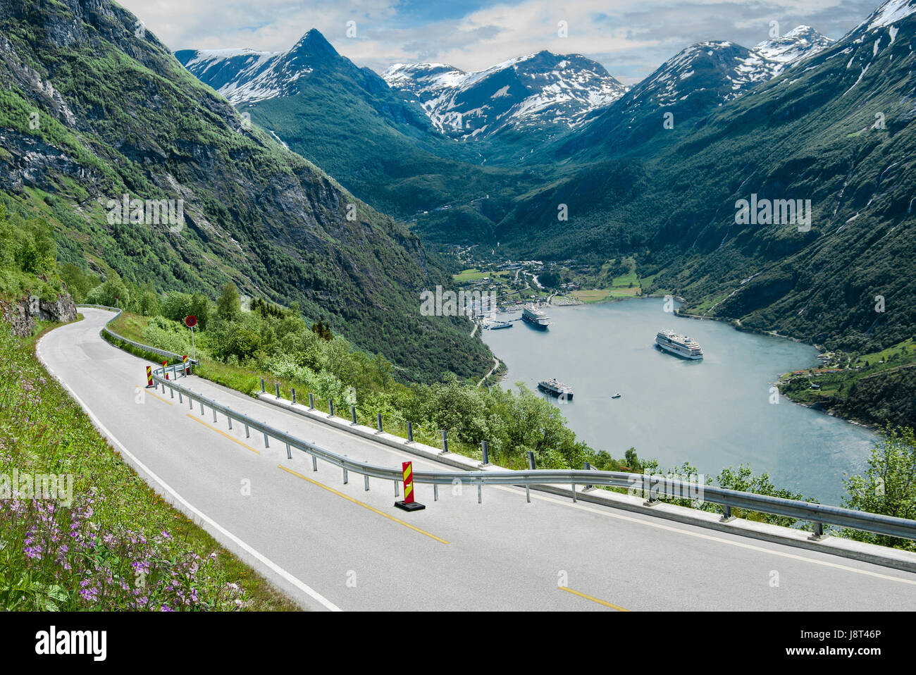 Fjord Road in Norway:  A two-lane road narrows as it descends beside Geirangerfjord in the mountains of southwest Stock Photo