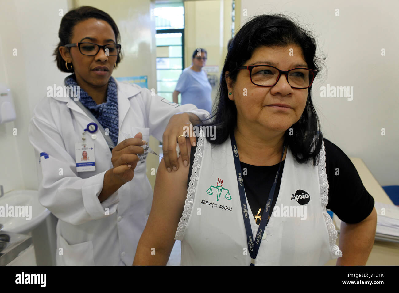 Annual vaccination campaign against influenza in a public health office at Sao Paulo city. This year with three Stock Photo