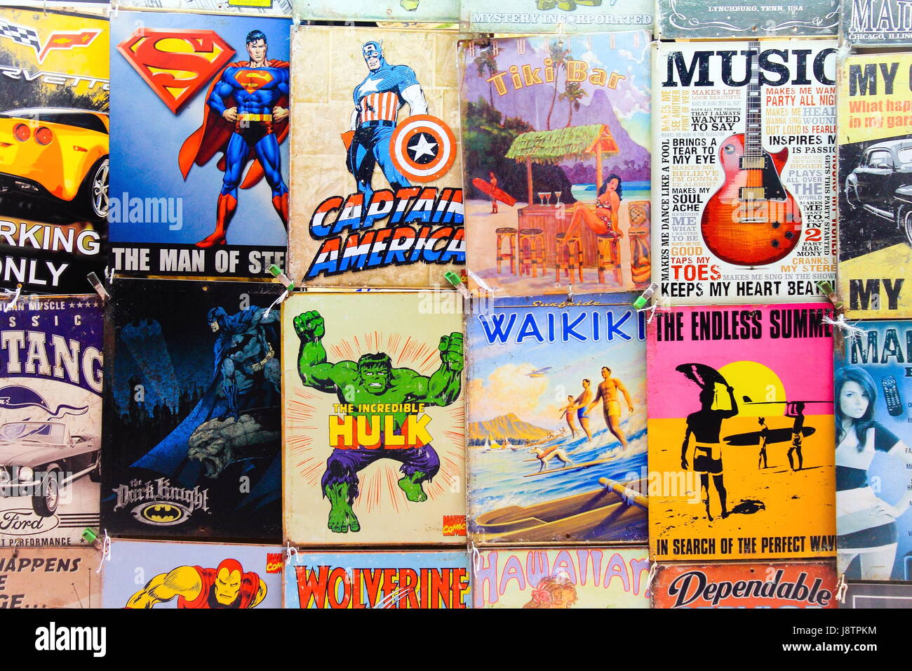 Old Comics and signs for sale at a Waikiki Market Stall - Stock Image