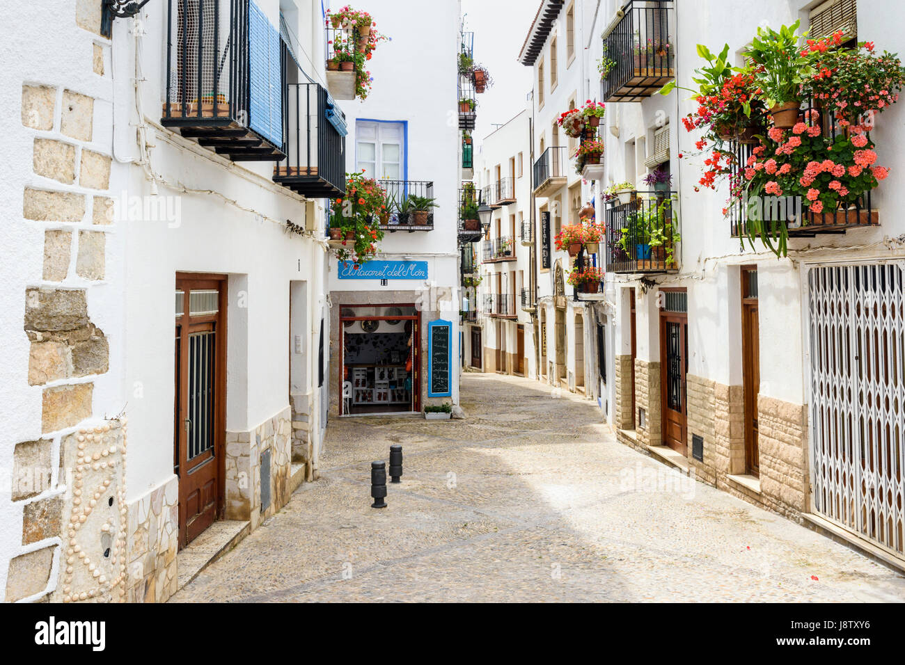 Picturesque cobbled street in the old town of Peniscola, Spain - Stock Image
