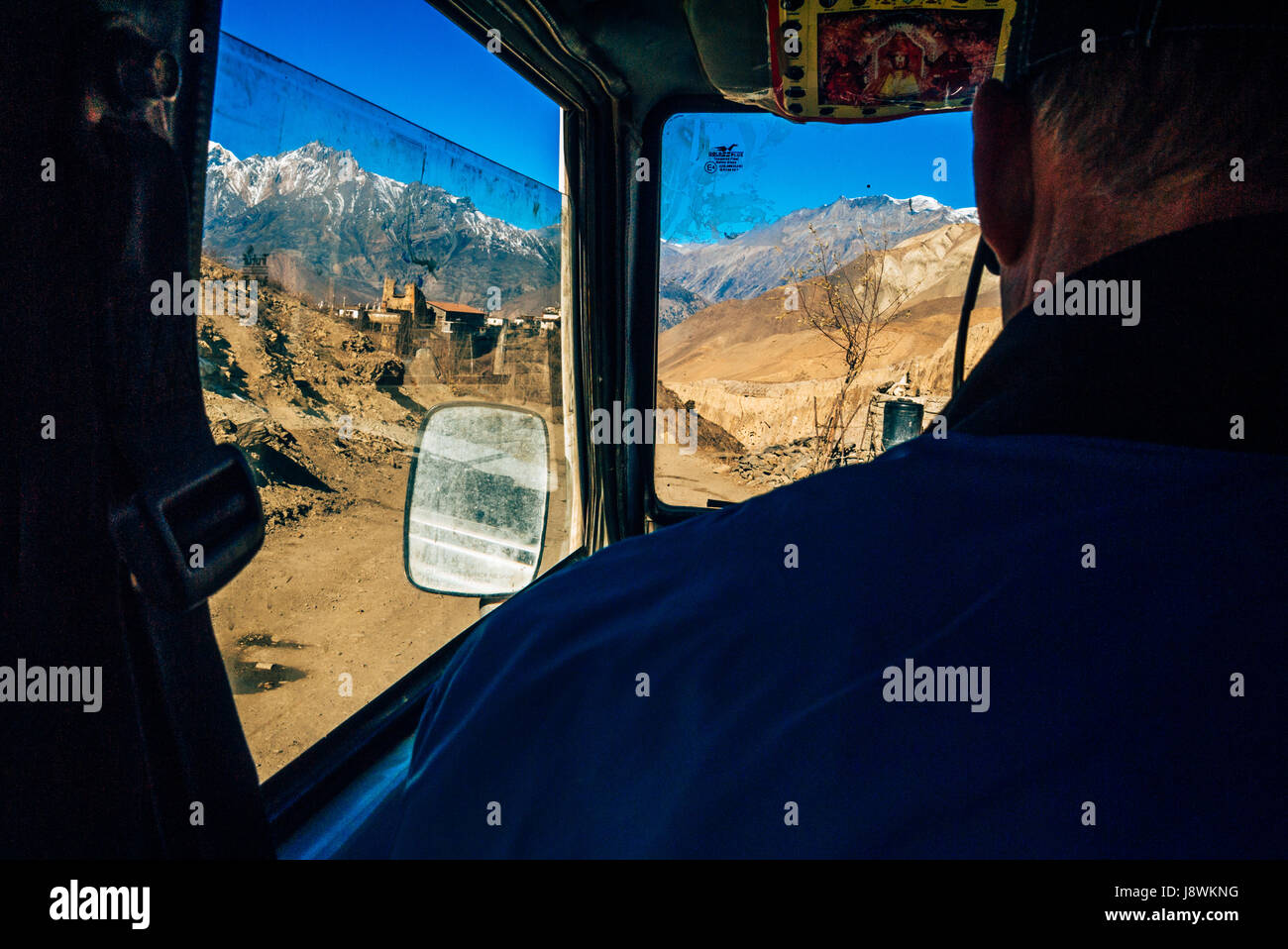 Driving on rugged mountain roads in the Himalayan mountains of Nepal. - Stock Image