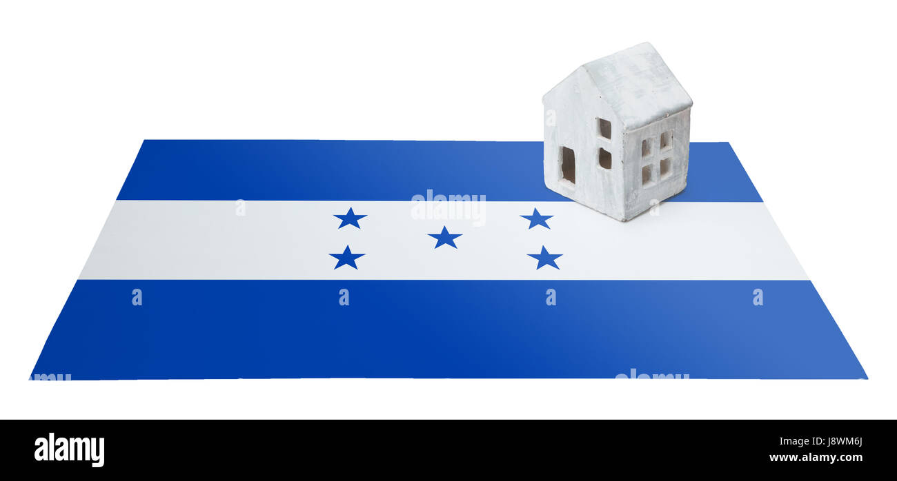 Small house on a flag - Living or migrating to Honduras Stock Photo