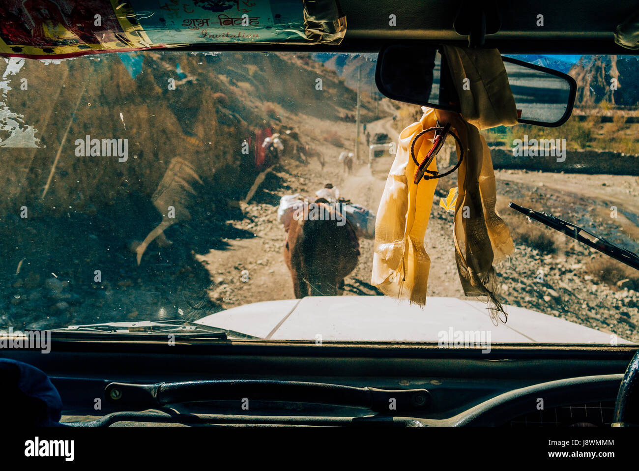 Driving on rugged dusty Himalayan mountain road within the Annapurna circuit in Nepal. - Stock Image
