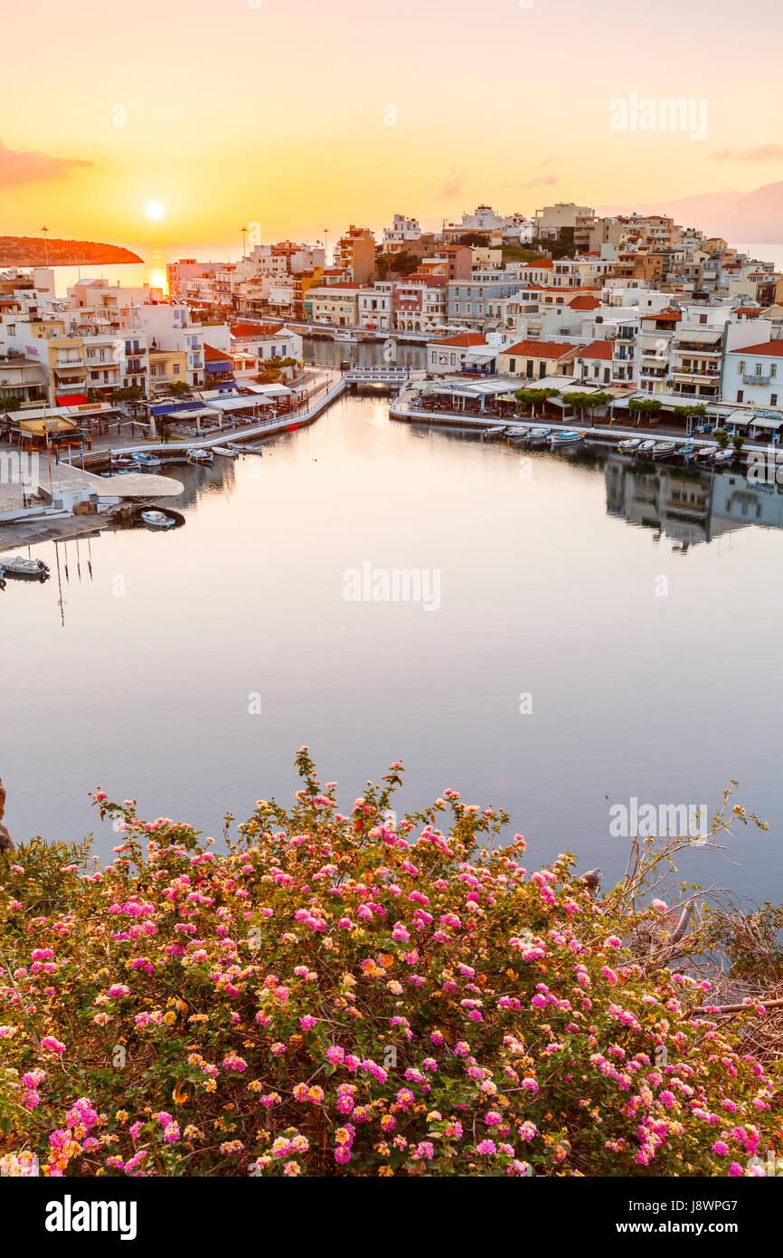 Morning view of Agios Nikolaos and its harbor, Crete, Greece. - Stock Image