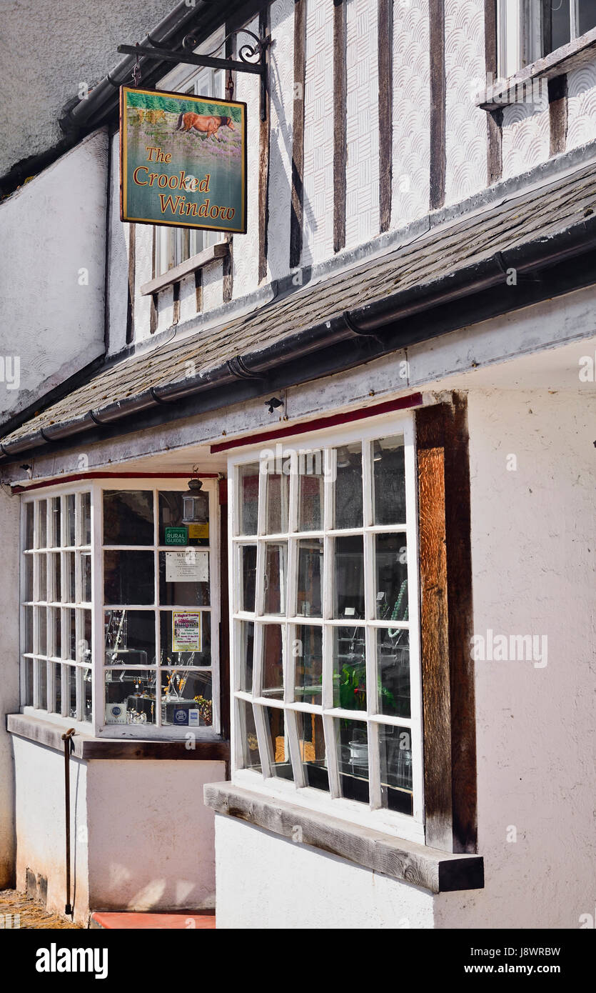 England, Somerset, Dunster, Shop named The Crooked Widow after architectural feature. - Stock Image