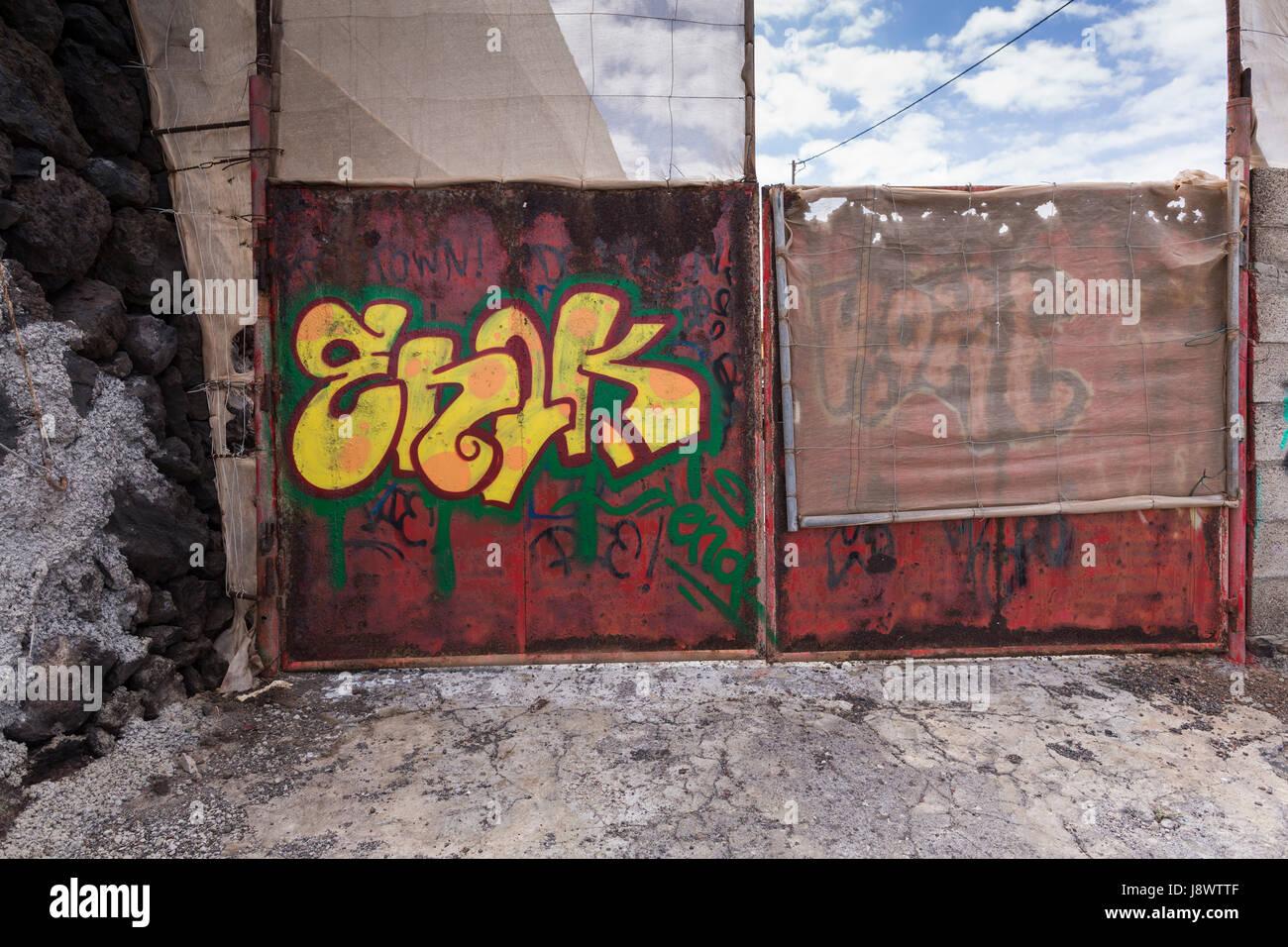 Graffiti painted with name enok on metal gate in playa san juan tenerife canary