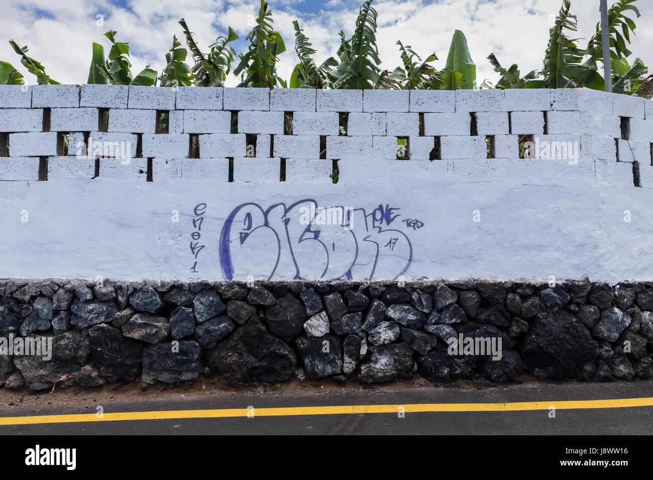 Graffiti painted with name enok on wall in playa san juan tenerife canary islands