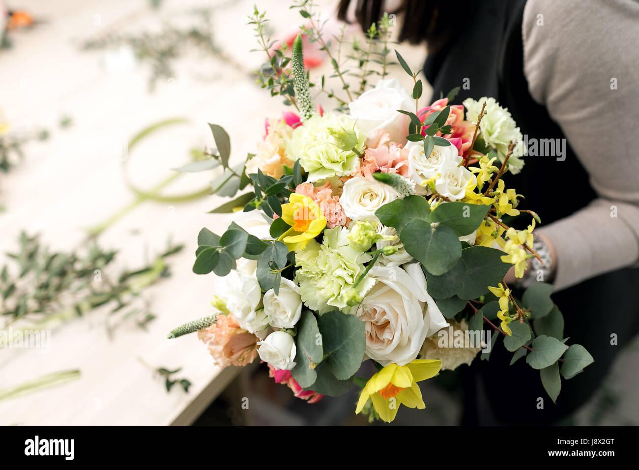 Workshop florist making bouquets and flower arrangements woman workshop florist making bouquets and flower arrangements woman collecting a bouquet of flowers soft focus izmirmasajfo