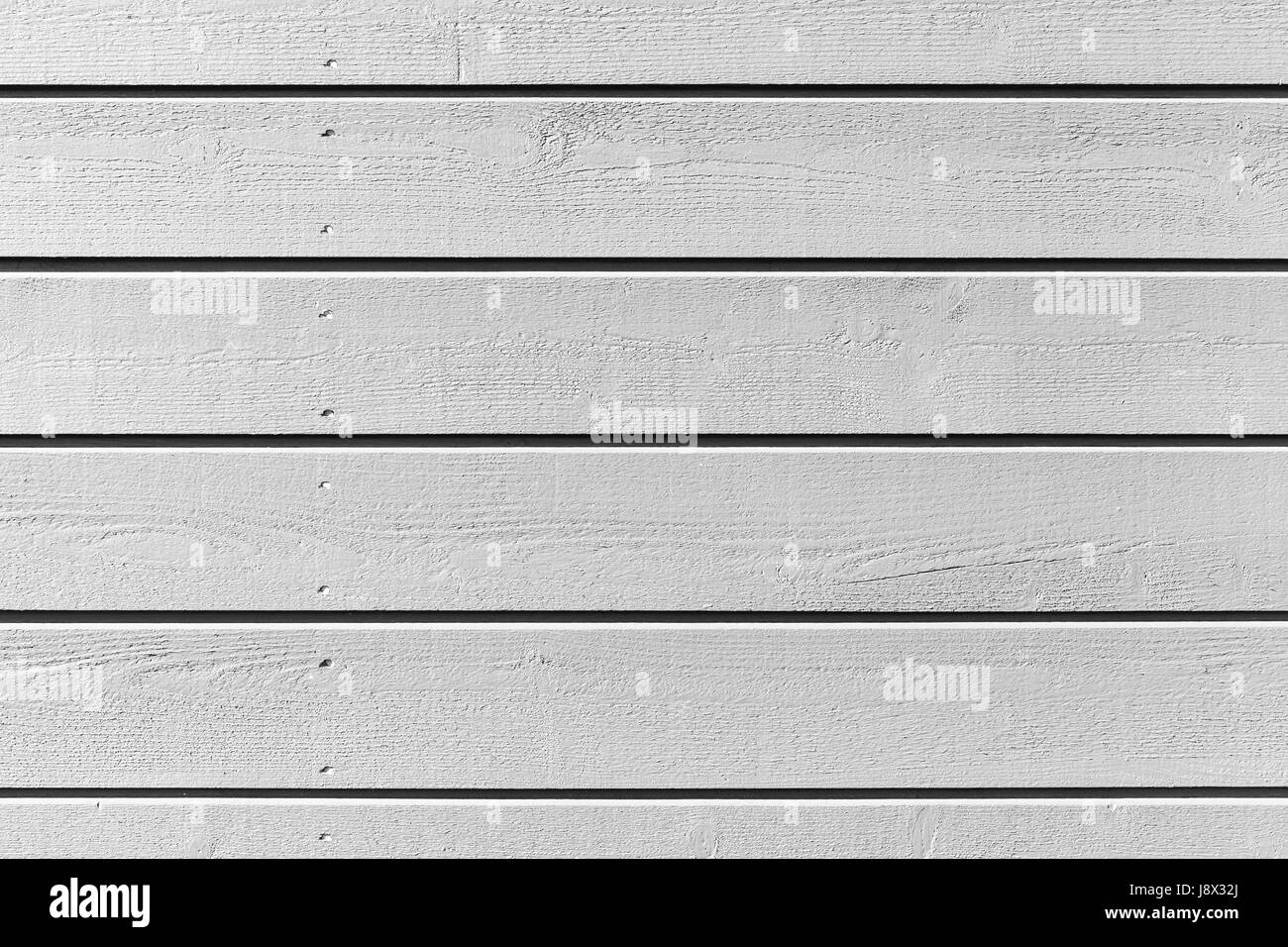 Natural white wooden wall made of planks with nails, background photo texture - Stock Image