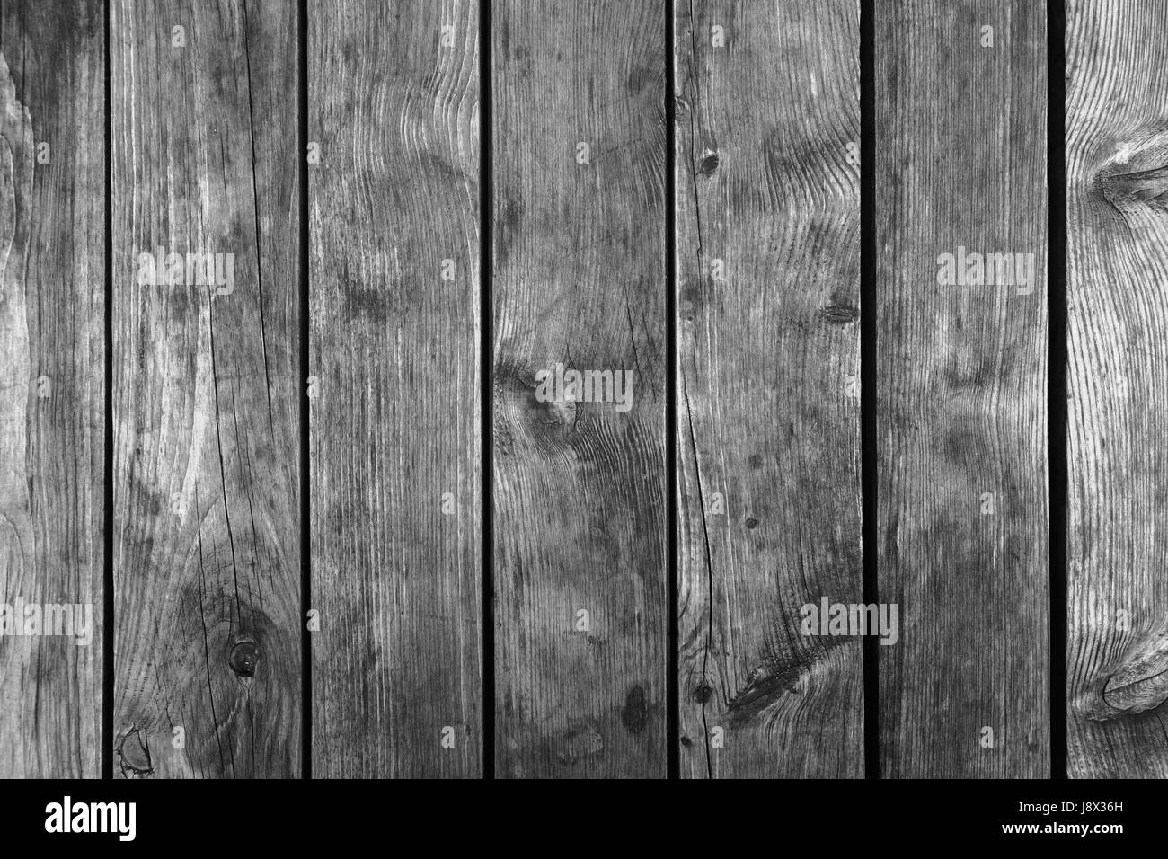 Old dark gray weathered wooden wall, flat background photo texture - Stock Image