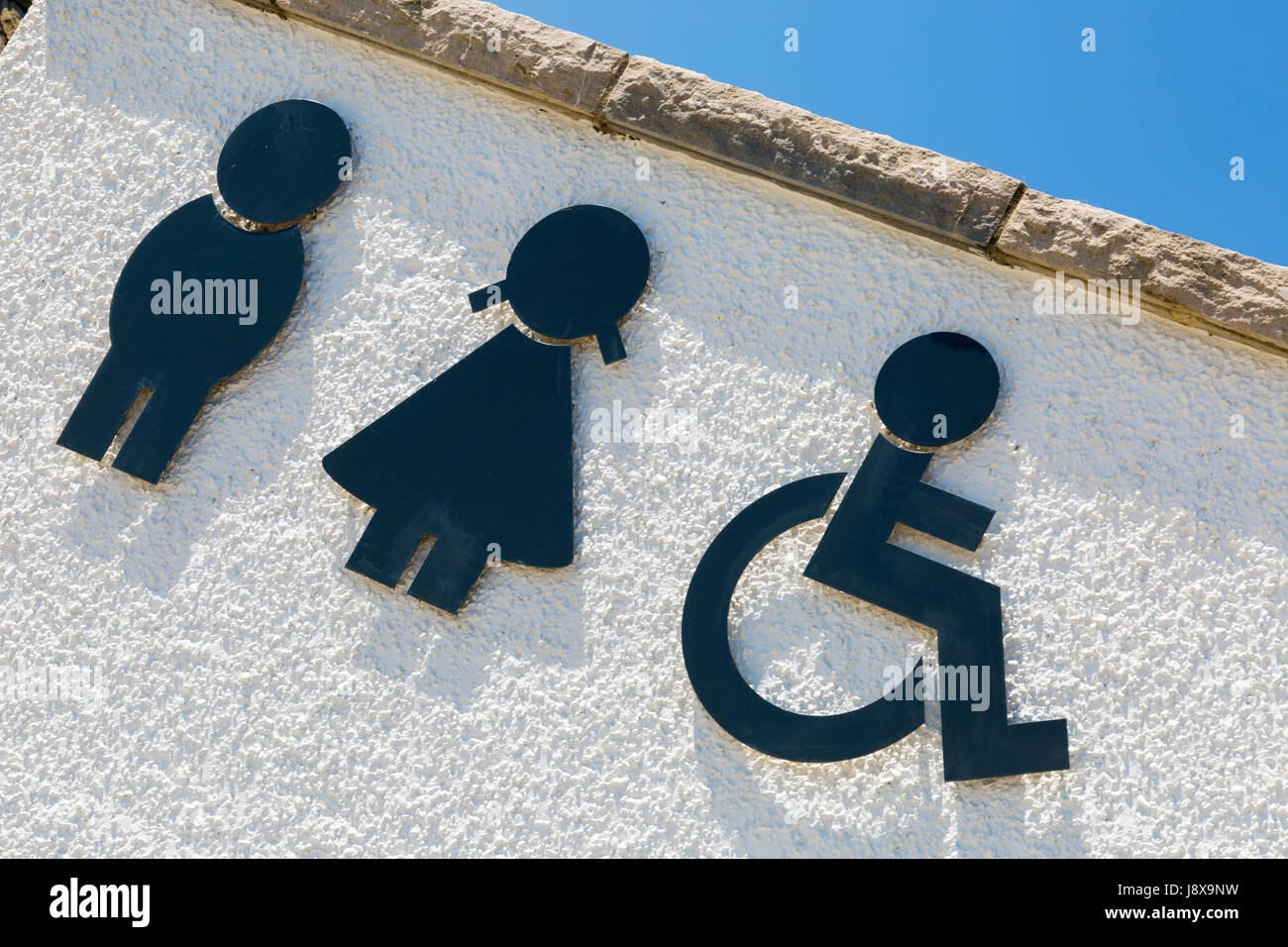 Toilets public conveniences symbols at Swanage, Dorset in May - Stock Image